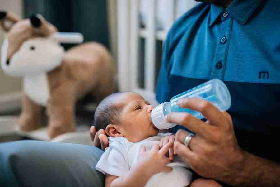 Dad feeding newborn
